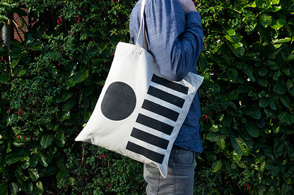 A shoulder tote bag filled with Third Circle beer